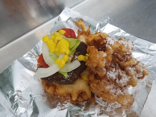 A single burger on a major funnel cake, complete with confectioners' sugar at the 2016 Indiana State Fair.