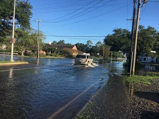 A vehicle drives through water over North Parkerson Avenue in Crowley Monday morning. The road leads to Interstate 10 and becomes La. Highway 13 to Eunice.