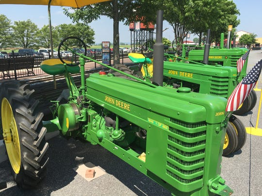 John Deere tractors line up on display at the Strasburg
