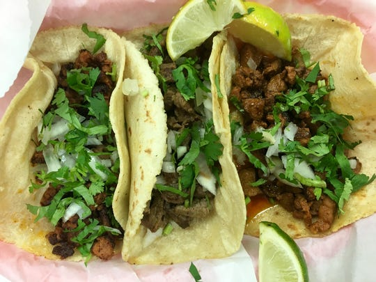 A trio of tacos with handmade tortillas from Taco Vazquez in Estero.