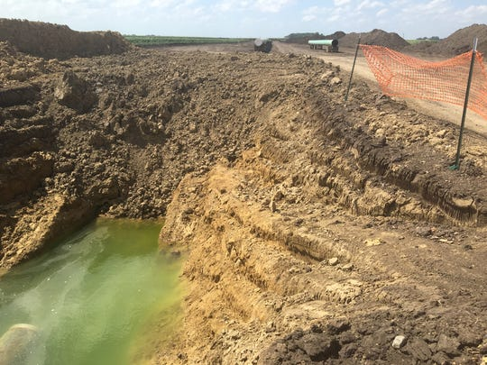Various soil colors are visible in a pit dug to house the Dakota Access pipeline on Francis Goebel's property in Granville, Ia.