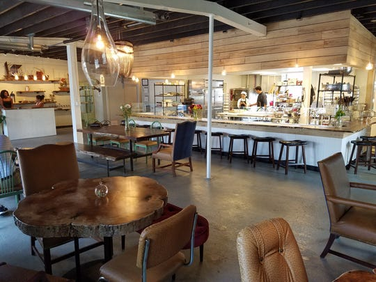 Natural wood tables, quirky chairs and a bar that provides an audience to the kitchen at The Gallery Pastry Shop, 1101 E. 54th St. in Indianapolis.