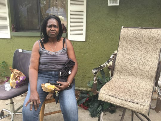 Dorothy Davis, the aunt of Willie Moore Jr, poses for a picture at a family member's home Saturday. Moore was found dead Friday night.