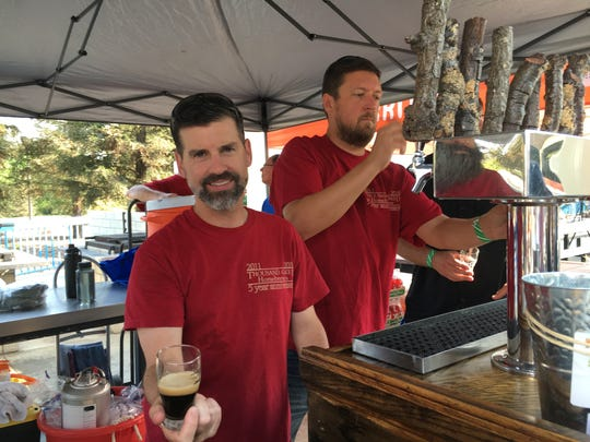 Thousand Oaked Homebrewers member Donovan Nebreklievski offers a taster of Smoked Porter during the Thousand Oaks BrewFest. The group is celebrating its 5th anniversary this month.