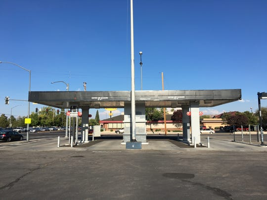 An abandoned gas station on Kietzke and Plumb lanes might be removed by Lithia Motors if they convert the shopping center into an auto dealership.