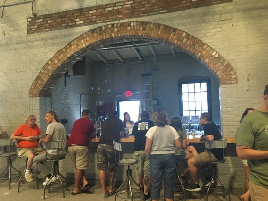 About 35 were in the Industrial Arts brewery Saturday