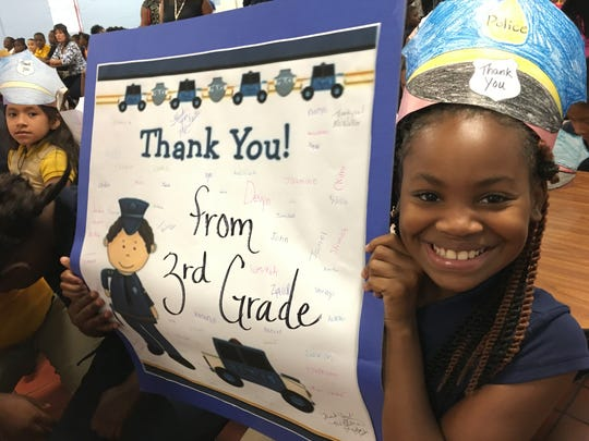 "Kennedy Biggs, 8, and a third grader at Highland Gardens Elementary School, shows her support for law enforcement at a ""Back the Blue"" presentation at her school on Tuesday, Sept. 6, 2016."