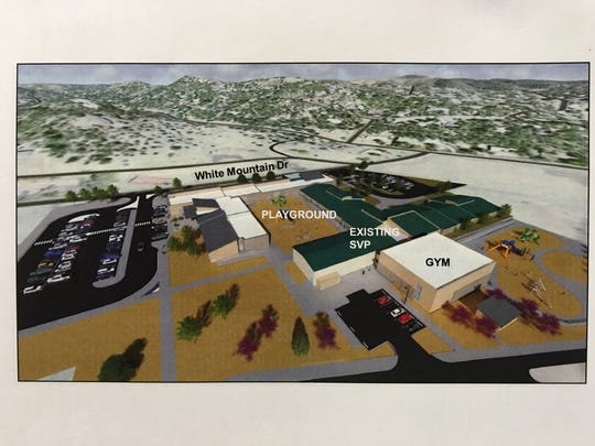 In this artist rendering, the green roof shows the existing Sierra Vista Primary school building, and the white roofed areas are the new kindergarten and pre-school and gymnasium spaces.