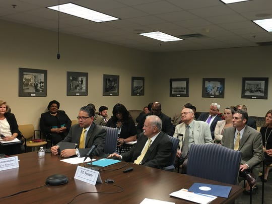 """Grambling State President Rick Gallot (seated, left) addresses the Finance Committee of the Louisiana Board of Regents Wednesday. Grambling was placed on """"fiscal watch"""" last month."""