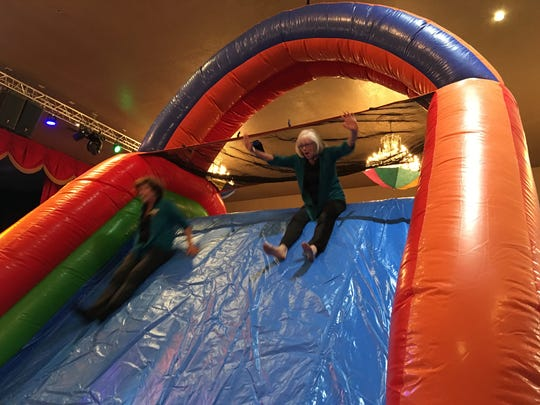 A pair of Ruidoso Valley Greeters find it's downhill all the way at Kids Fit and Fun during Tuesday's Business After Hours.