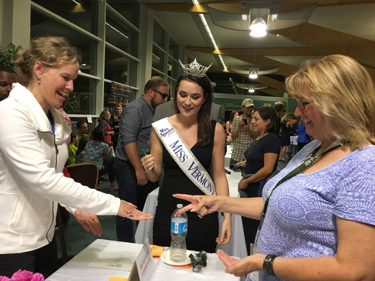 Neely Fortune, who holds the title of Miss Vermont, serves as the community judge while Alison Rogers of Hickok & Boardman HR Intelligence, left, plays against Jill Vespa of Coldwell Banker Hickok & Boardman Realty at the Rock Paper Scissors fundraiser for ANEW Place on Wednesday, Sept. 21, 2016, at Burlington International Airport.