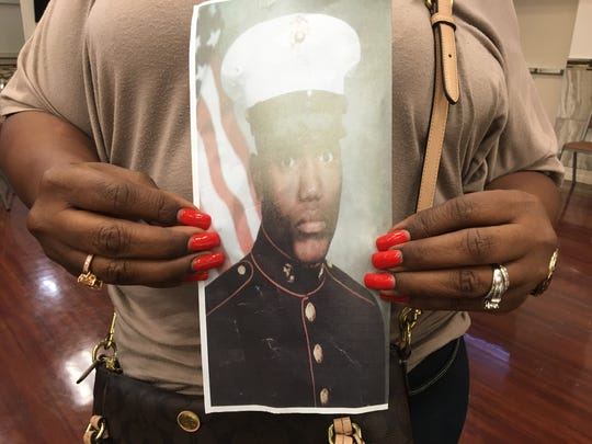 Veronica Jones-Greene,  holds picture of her brother Keith Jones. Keith was killed in Fort Myers almost 20 years ago and his homicide remains unsolved.