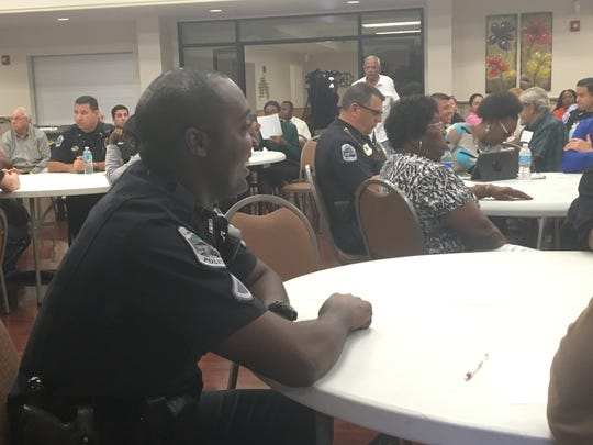 Fort Myers Police Officer Eddie Brown listens to a presentation meant to bridge the divide between police and the Fort Myers community.
