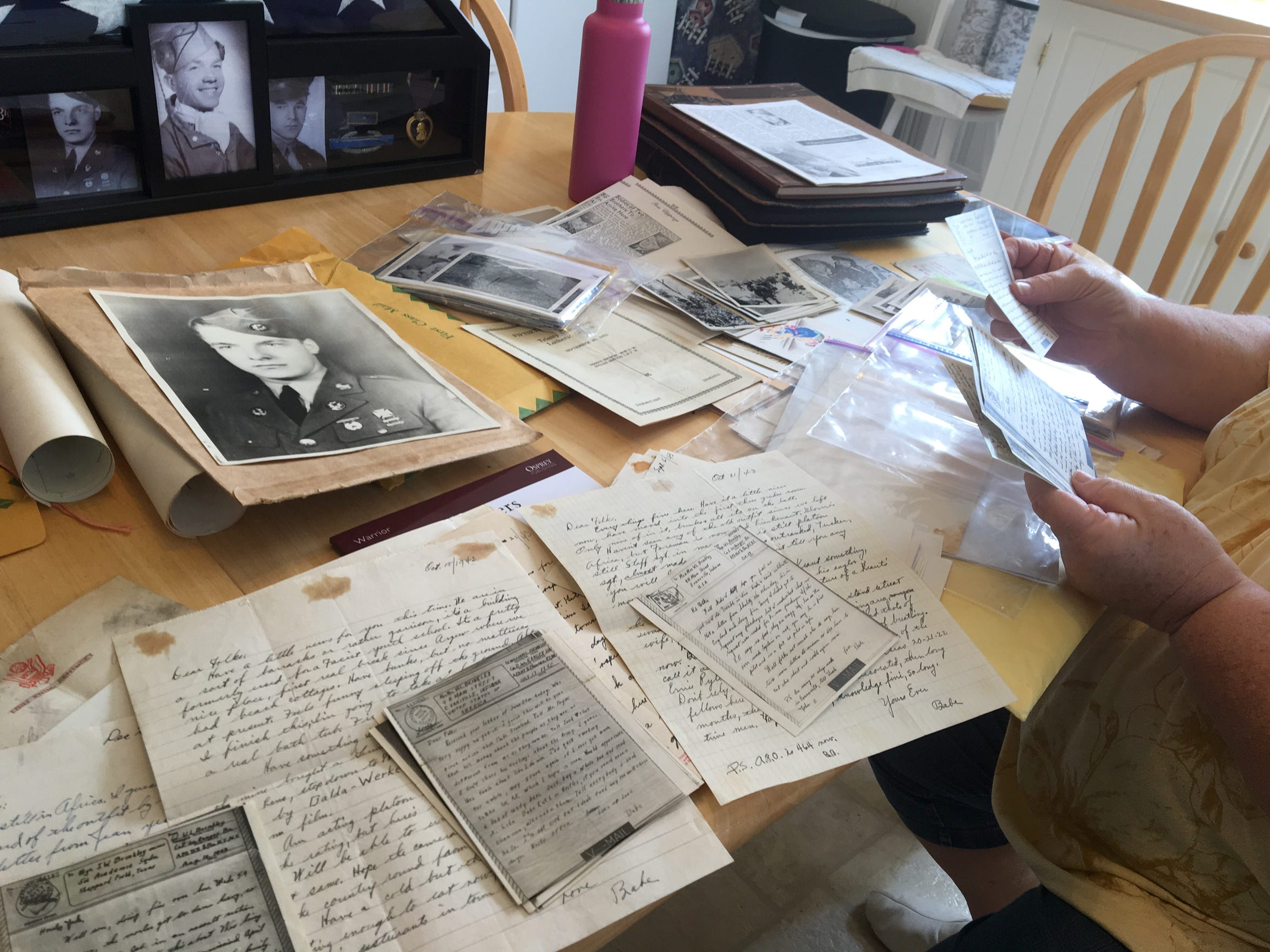 Jill Brinkley thumbs through a pile of letters sent by the Brinkley family during WWII