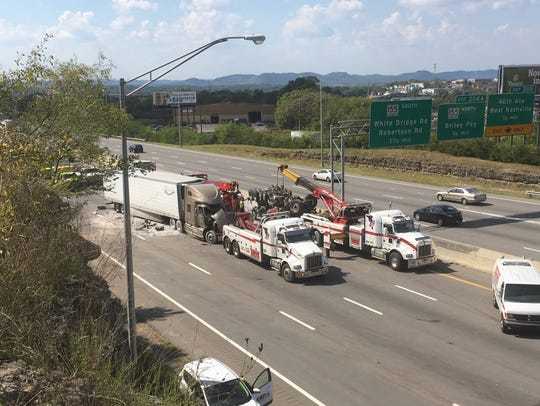 Interstate 40 east was blocked Friday after a dump