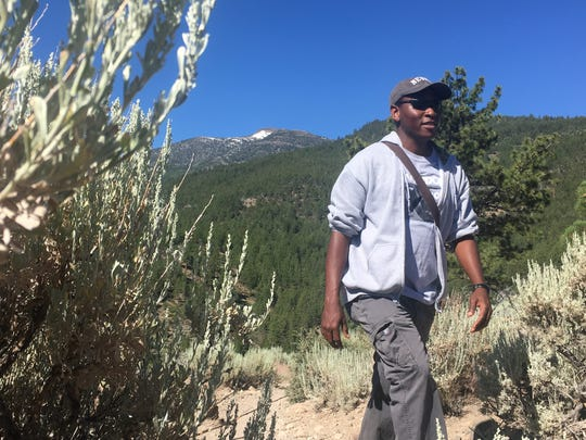 Hiker Israel Borokini of Reno says people are often surprised to see a black man hiking on wilderness trails.