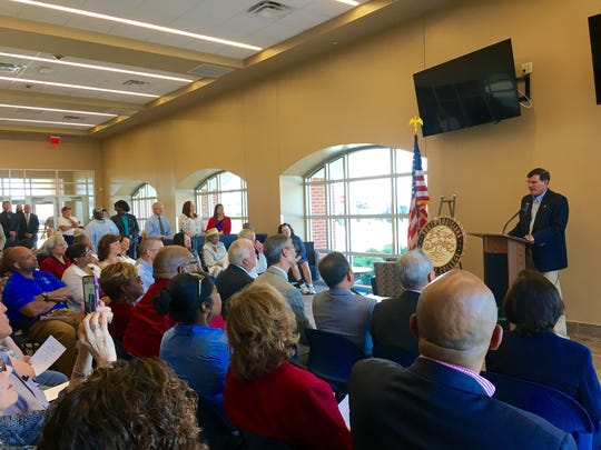 Andy Andolesk with Levert Companies addresses a room of officials from South Louisiana Community College, St. Martinville and the surrounding area Wednesday as they celebrate a new campus built on 9 acres donated by the Levert family.