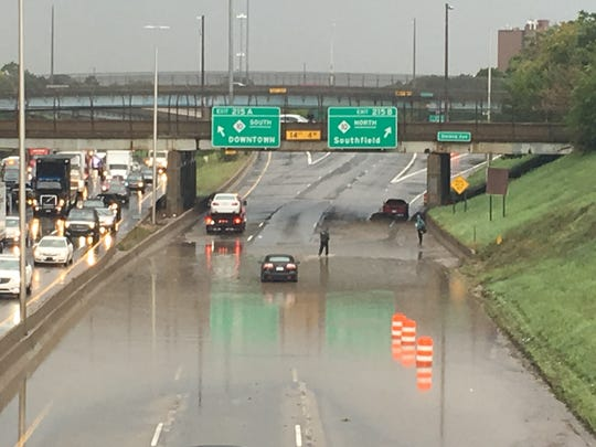 Flooding is visible on the Lodge Freeway at I-94.