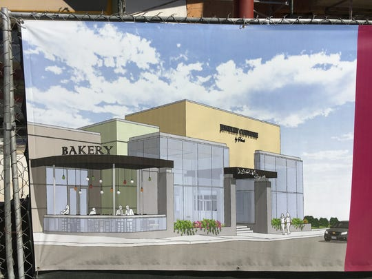 An architectural rendering is displayed on construction fencing at the future site of Cafe Ficelle in Ventura. Its existing neighbor, Jewelry Couture, is open during remodeling of the building's facade.