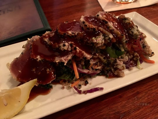 An appetizer of seared tuna and quinoa from University Grill in south Fort Myers.
