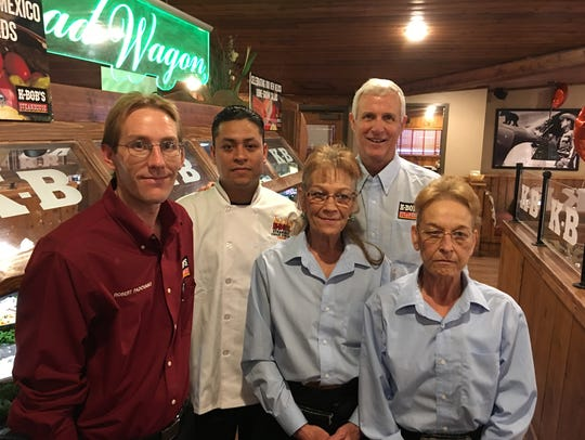Ruidoso K-BOB'S owner Ed Tinsley poses with four of