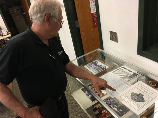 "Jim Miller Jr., who was hired in 1991 as ""campus director"" and was given six weeks to hire faculty and start classes, reminisces Wednesday in the ENMU library."
