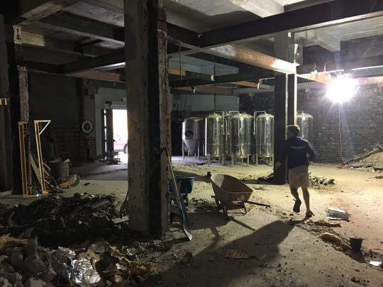 Eastern Market Brewing Co. co-owner Paul Hoskin on Oct. 12, 2016 walks through the 5,200 square-foot property planned to open in spring 2017 on Riopelle in Detroit's Eastern Market.