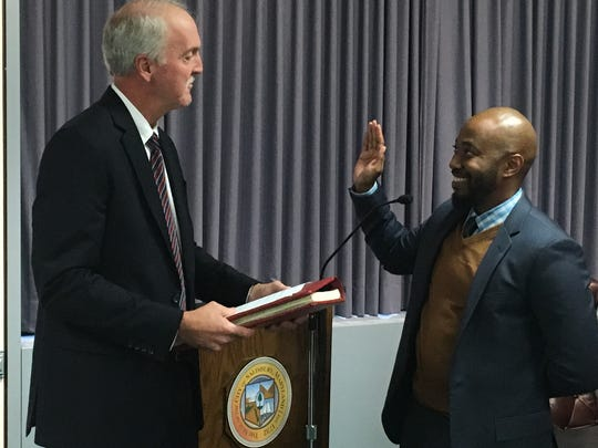 R. Hardy Rudasill, right, is sworn in as the newest Salisbury City Council member on Oct. 24, 2016 by Mark S. Bowen, Wicomico County Clerk of the Courts.