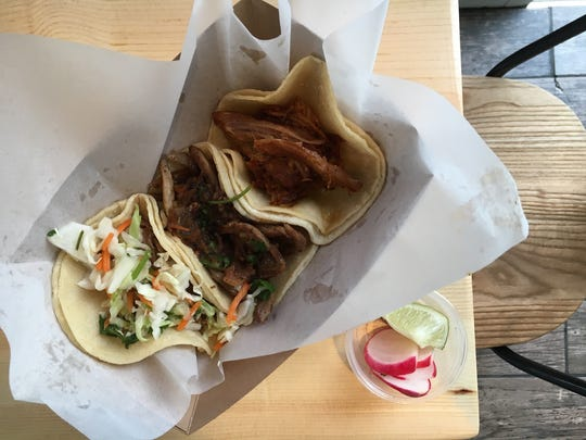 A trio of Yucatan Peninsula-specialty tacos is seen at Bad Ass Street Tacos in Thousand Oaks. From left, they are lechon, poc chuc and cochinita pibil. Formerly located after hours at Thousand Oaks Meat Locker BBQ, the street-tacos restaurant is now open at the former location of Dayne's Chicago Beef & Dawgs on Thousand Oaks Boulevard.