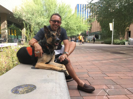 Patricio Espinoza with his service dog, Frida.