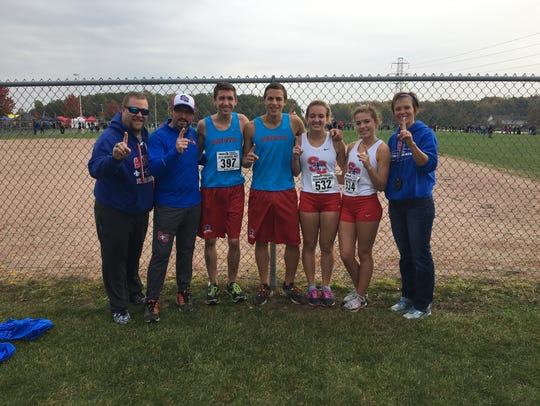 Davidson with his runners after winning a regional meet.