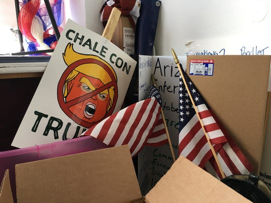 "A ""Chale con Trump"" picket sign sits among loose campaign"