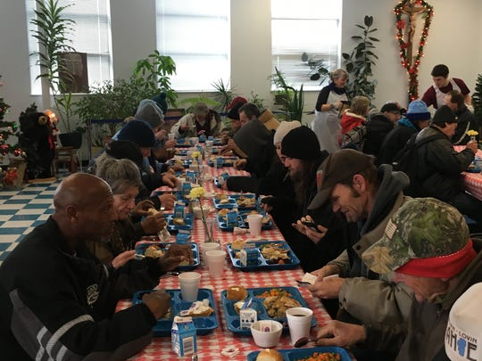 People in need enjoy a holiday meal last year at St. Vincent's Dining Hall.