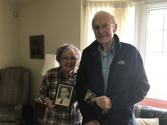 Charles Ware Sr., right, and his wife, Alice Ware, hold family photos. Alice holds a picture of Charles's father, Thomas Ware Sr., and Charles hold a picture of his brother, Thomas Ware Jr. when he attended West Point.