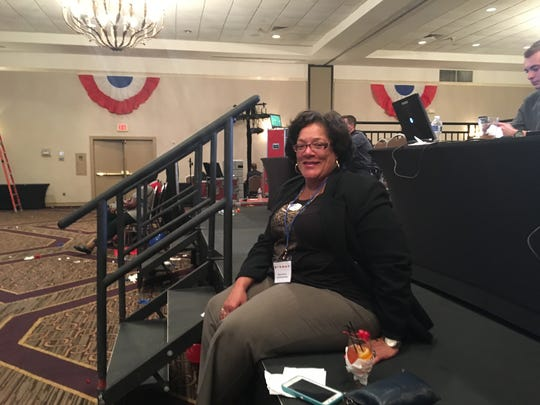 Lisa Cornelius sits on a stage at the Delaware Democratic Party event at the DoubleTree Hotel in Wilmington on Tuesday.