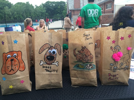 """Detroit Recreation Department and Detroit Dog Rescue team up for first ever """"Pool Pawty"""" - a pool party for dogs at Brennan Pool at Rouge Park in Detroit. Each dog received a doggie-bags treat."""