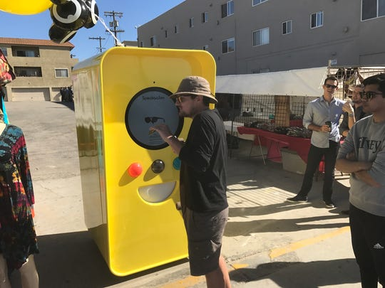 A consumer stands in line waiting to buy Snapchat's