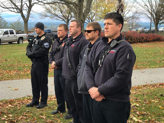 Members of Burlington's fire and police departments participate in the city's annual commemoration of Veterans Day, Nov. 11, 2016, in Battery Park.
