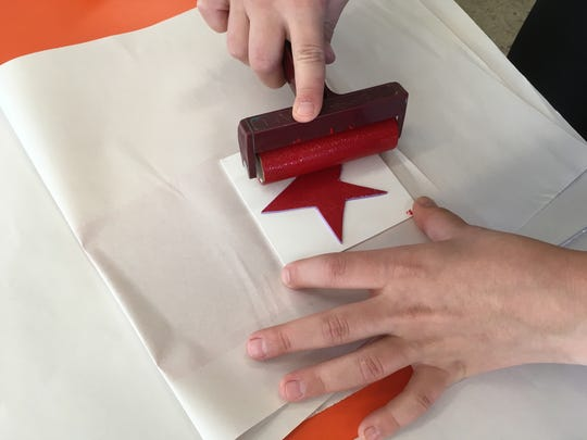 Make wrapping paper with handmade shapes, paint and newsprint.