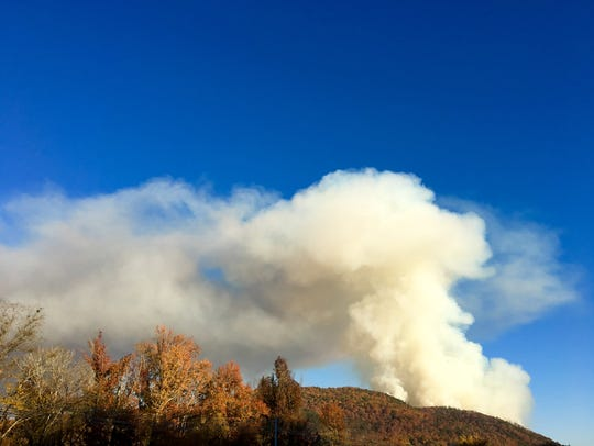 Smoke billows from a forest fire on Thursday, Nov.