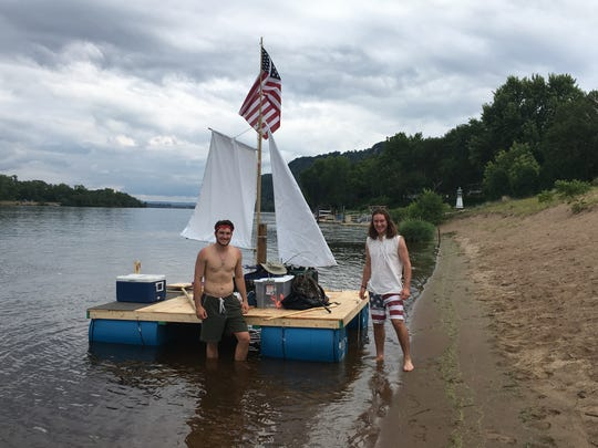 Nick Smith (left) and cousin Gregory Smith sailed a raft on the Mississippi River this summer as part of a project checking items off their bucket list with friends Kevin Reardon and Owen Gibson.