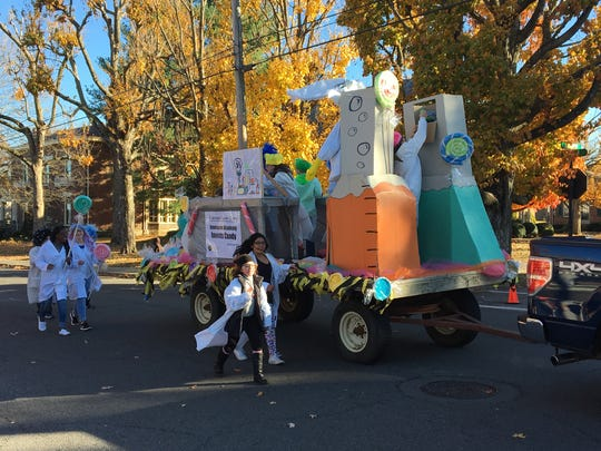 The Innovation Academy float makes it's way through Springfield during the city's annual Christmas Parade.