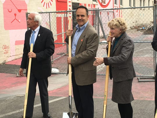 Gov. Matt Bevin (center) breaks ground on Duveneck Square with Covington Mayor Sherry Carran (right) and Covington City Commissioner Chuck Eilerman (left)