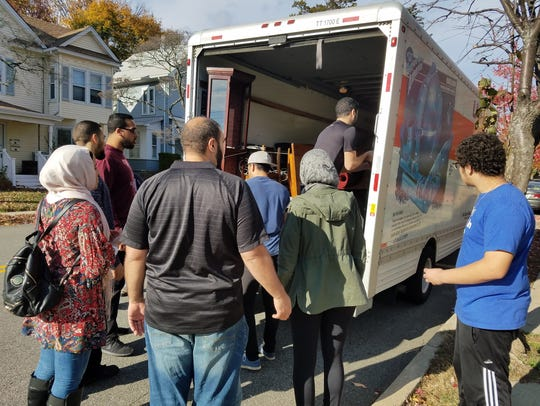 Volunteers work in Boonton to furnish an apartment