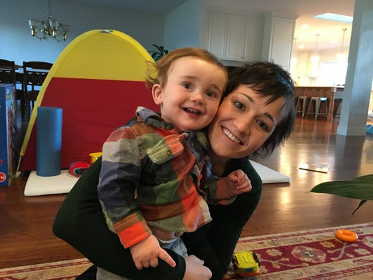 Kristin Sunbot holds her son, August, in her mother's house in Reno.