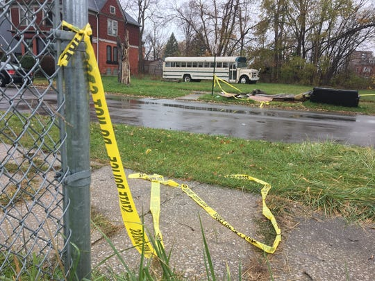 Police tape left Nov. 23, 2016, on Lincoln north of Martin Luther King Jr. Boulevard in Detroit's Woodbridge neighborhood marks the area where Wayne State University Police Officer Collin Rose, 29, was shot.