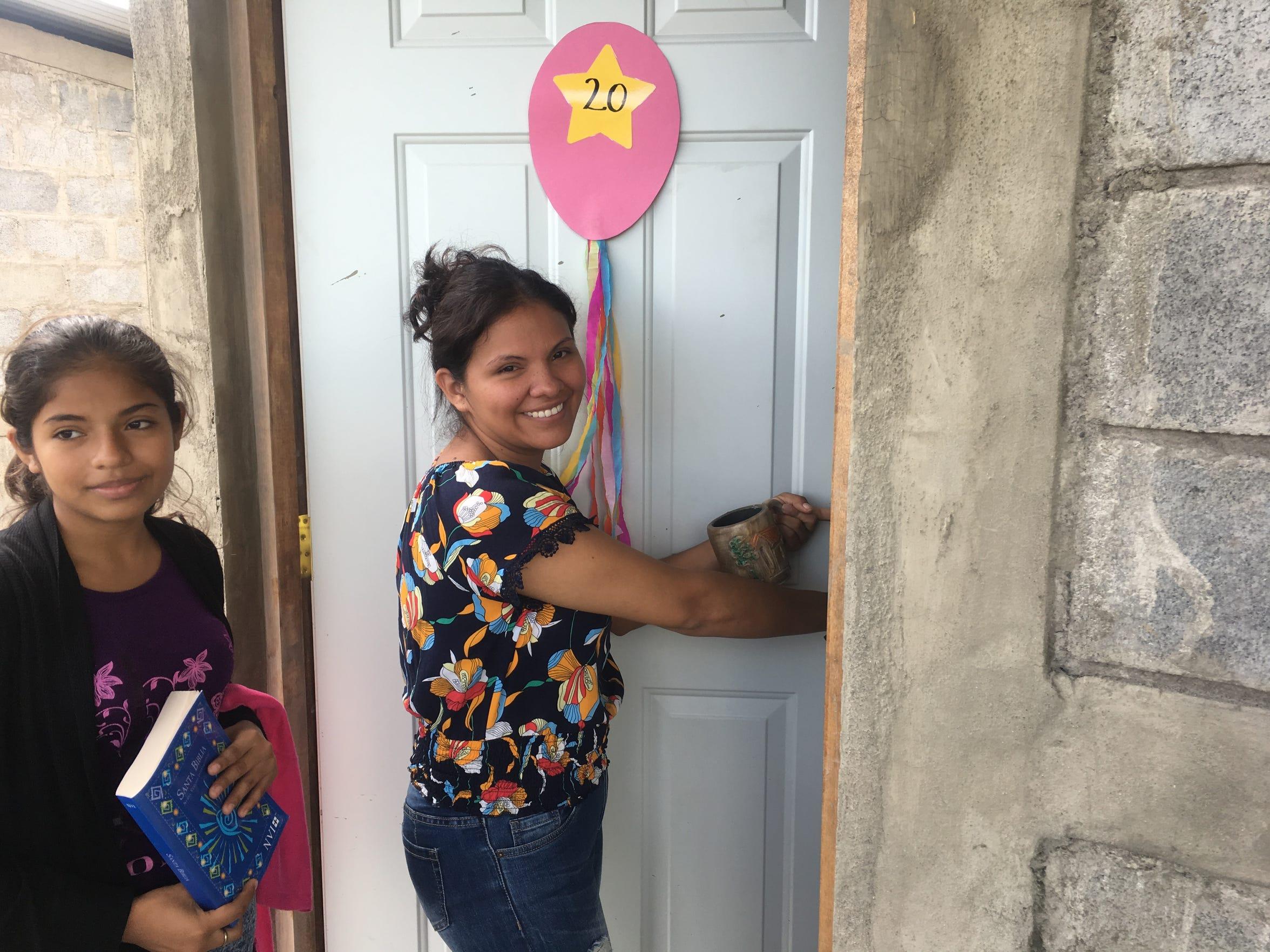 Sayda Patricia Alfaro Rueda opens the door to her family's