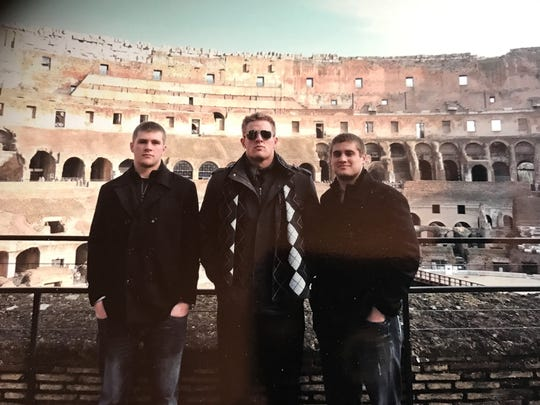 The Watt brothers (from left) TJ, JJ and Derek pose together at the Colosseum in Rome during a recent family vacation.