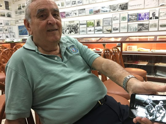 Caption: Esteban Bovo shows a picture of when he was a young pilot in the Cuban Air Force. Bovo was part of 2506 Brigade who attempted to overthrow Fidel Castro's government in 1961 during the Bay of Pigs invasion.