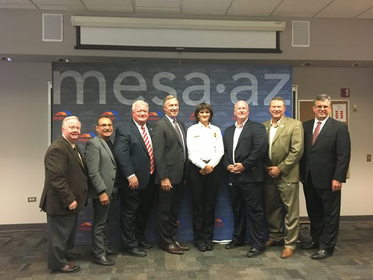 Mary Cameli poses with Mesa Mayor John Giles and City Council members on Dec. 1, 2016, after she was named the city's new fire chief.